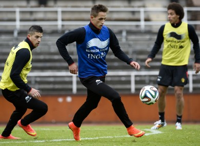 Januzaj training with Belgium's Kevin Miralles (left) and Axel Witsel.