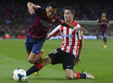 Herrera slides in on Barcelona's Alexis Sanchez.
