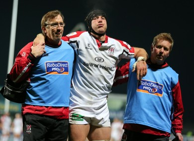 Ferris is helped off the pitch during a league game against Edinburgh in 2012.