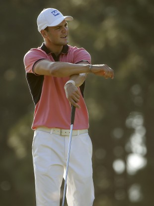 Martin Kaymer, of Germany, reacts after missing a putt on the 13th hole during the third round of the U.S. Open golf tournament in Pinehurst