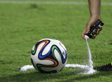 A referee practises using vanishing spray during a training session.