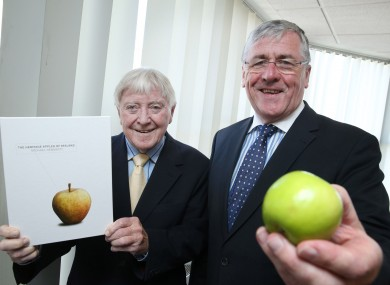 Michael Hennerty and Tom Hayes. With an apple.