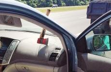 Lucky escape after axe smashes through car window on dual carriageway