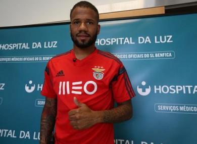 Bebe in a Benfica shirt.