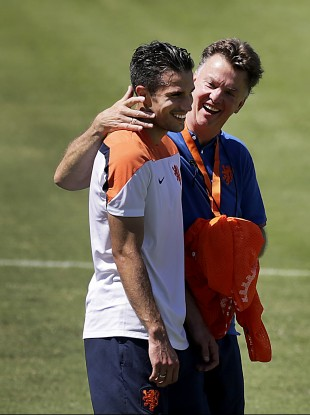 Football friends: Coach Louis van Gaal, right, shares a light moment with Robin van Persie.