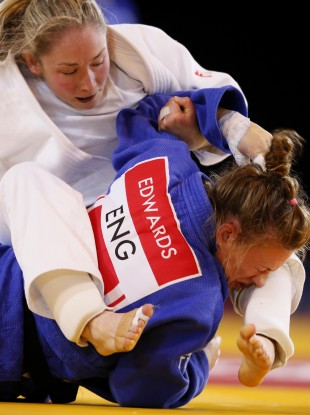 Lisa Kearney (white) in action against England's Kelly Edwards today.