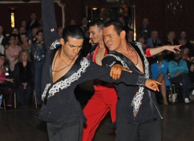 Sergio Brilhante, left, and Jonathan Morrison take part in a ballroom dancing competition