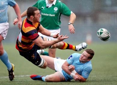 Butterworth offloads during an Ulster Bank League clash with Garryowen.