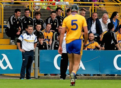 Davy Fitzgerald looks on as Brendan Bugler leaves the field after being sent off.