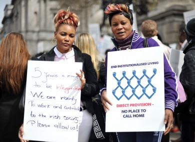 Bijoux Nseya (left) and Natalie Mundeke protest outside Leinster House this afternoon calling for an end Direct Provision.