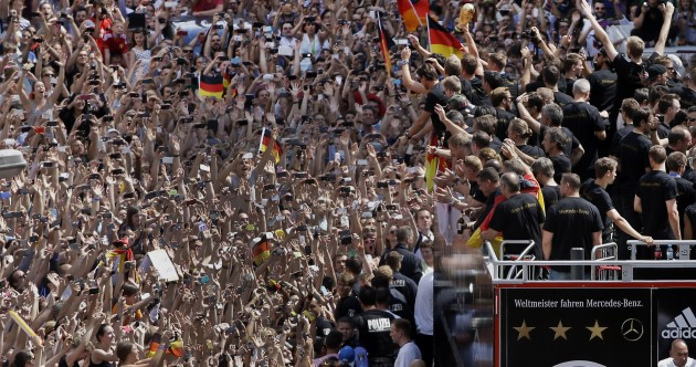 Germany dance back into Berlin on massive open-top Merc truck