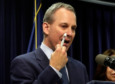 New York state Attorney Gen. Eric Schneiderman demonstrates an inhaler of naloxone, one of two included in an Overdose Prevention Rescue kit.