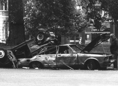 File photo: Forensic officers examine the remains of the car which housed the Hyde Park bomb which killed four soldiers in July 1982.