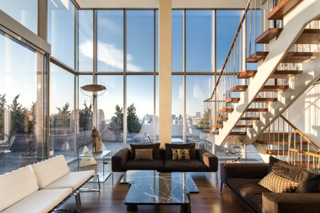 inside-theres-a-modern-staircase-made-of-steel-and-glass