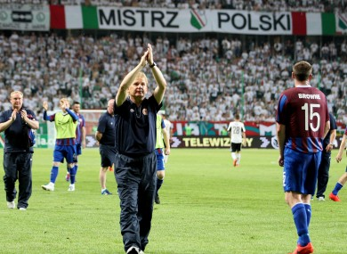 Liam Buckley applauds the St Pat's fans in Poland.