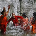 Nepalese Hindu devotees play before collecting water from the Bagmati river during the