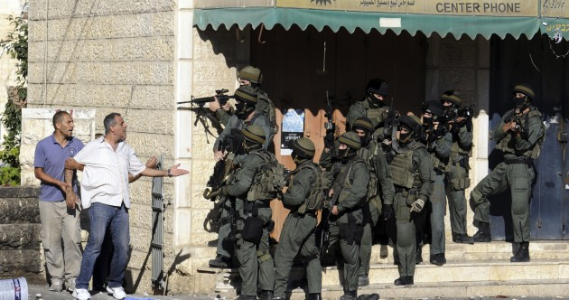 Riots, tension, and fears of retaliation as killing of Palestinian teenager sparks rioting