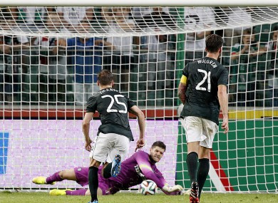 Fraser Forster saves a penalty in Warsaw last night.
