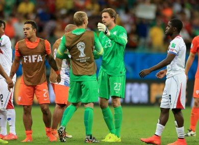 Netherlands goalkeeper Jasper Cillessen (left) and Tim Krul celebrate winning the penalty shoot-out.