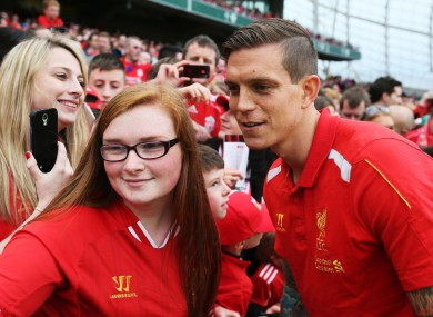 Liverpool's Daniel Agger poses for a photo with a supporter at half time at the Aviva Stadium in May.
