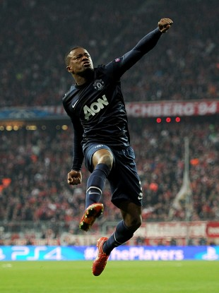 Patrice Evra celebrates his thunderbolt against Bayern Munich this season.