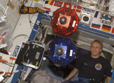 The SPHERES floating on board the International Space Station.