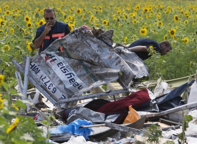 Dutch investigators examine pieces of the crashed Malaysia Airlines Flight.