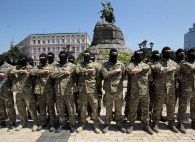 Volunteers in in Kiev yesterday taking an oath of allegiance to Ukraine, before being sent to the eastern part of Ukraine to join the ranks of special battalion