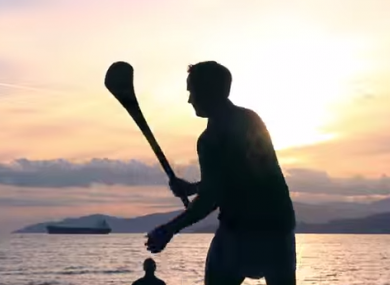 A hurler having a puck about near Kitsilano Beach.