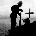 A British soldier pays his respects at the grave of a colleague near Cape Helles, where the Gallipoli landings took place.<span class=