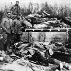 Wagon loads of German dead being removed in Verdun, France.<span class=
