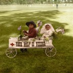 A young boy and girl ride in a decorated toy car to promote the Red Cross during a charity fundraising event in Adelaide, Australia.<span class=