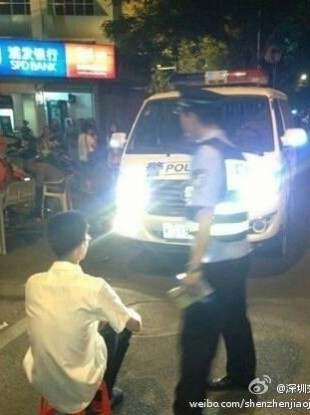 The image released by Shenzhen police, apparently showing somebody being forced to stare into high-beams.