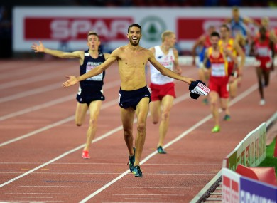 France's Mahiedine Mekhissi-Benabbad takes his shirt off in the Men's Steeplechase Final.