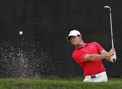 Rory McIlroy, of Northern Ireland, hits from a bunker on the 13th hole during the first round of play at The Barclays golf tournament.