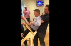Grown man gets hilariously stuck in baby's high chair