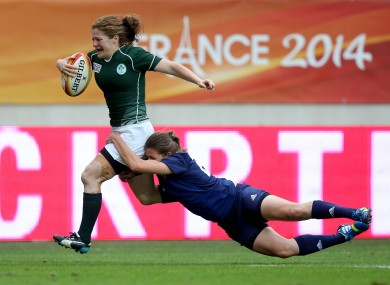 Grace Davitt bursts towards the French line for her try on the stroke of half-time.