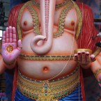An Indian man climbs a 60 feet idol of elephant-headed Hindu god Ganesha to decorate it in preparation for the upcoming Ganesha Chaturthi festival in Hyderabad, India.<span class=