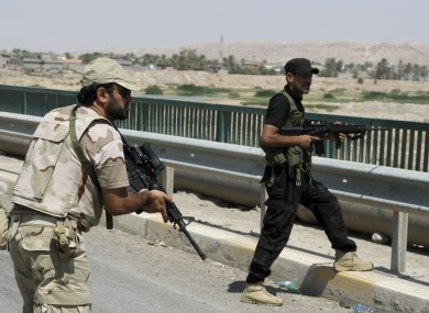 Iraqi security forces and Shiite militiamen in Amirli today.
