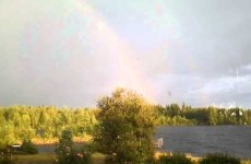 Rainbow admirer narrowly misses being hit by lightning