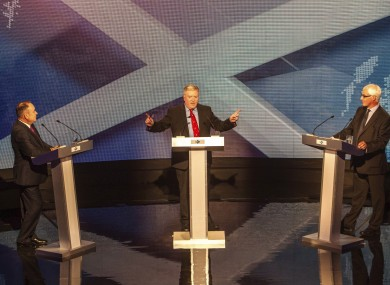 Alex Salmond (l), Alistair Darling (r) and moderator Bernard Ponsonby (c) during the debate tonight.