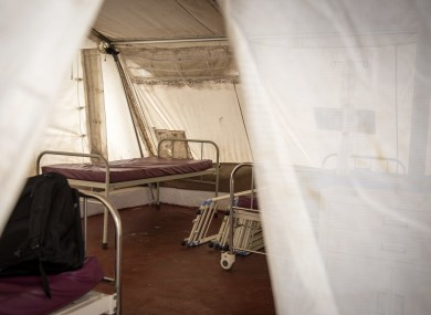 Beds for patients are seen inside a tent at the recently opened but unstaffed Ebola treatment center in the village of Lakka on the outskirts of Freetown, Sierra Leone.