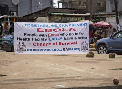 A banner in Sierra Leone encouraging those suffering from Ebola to go to the health centre.