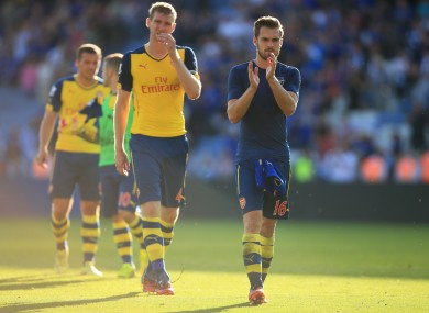 Arsenal's Aaron Ramsey (right) and Arsenal's Per Mertesacker (left) dejected after the Barclays Premier League match at the King Power Stadium.