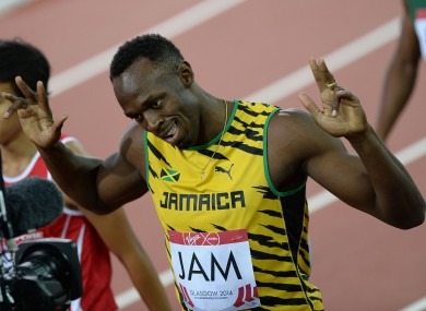 Bolt celebrates Jamaica's qualification for the final.