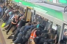 Passengers use collective strength to push train off trapped man