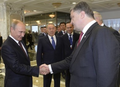 Russian President Vladimir Putin shakes hands with his Ukrainian counterpart Petro Poroshenko before talks in Minsk.