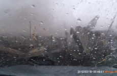 Russian man reverses out of his garage straight into a massive tornado