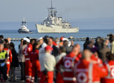 Italian Navy frigate carrying the victims and the survivors of a migrant boat that sank in May.