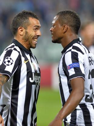 Tevez celebrates with teammate Patrice Evra.